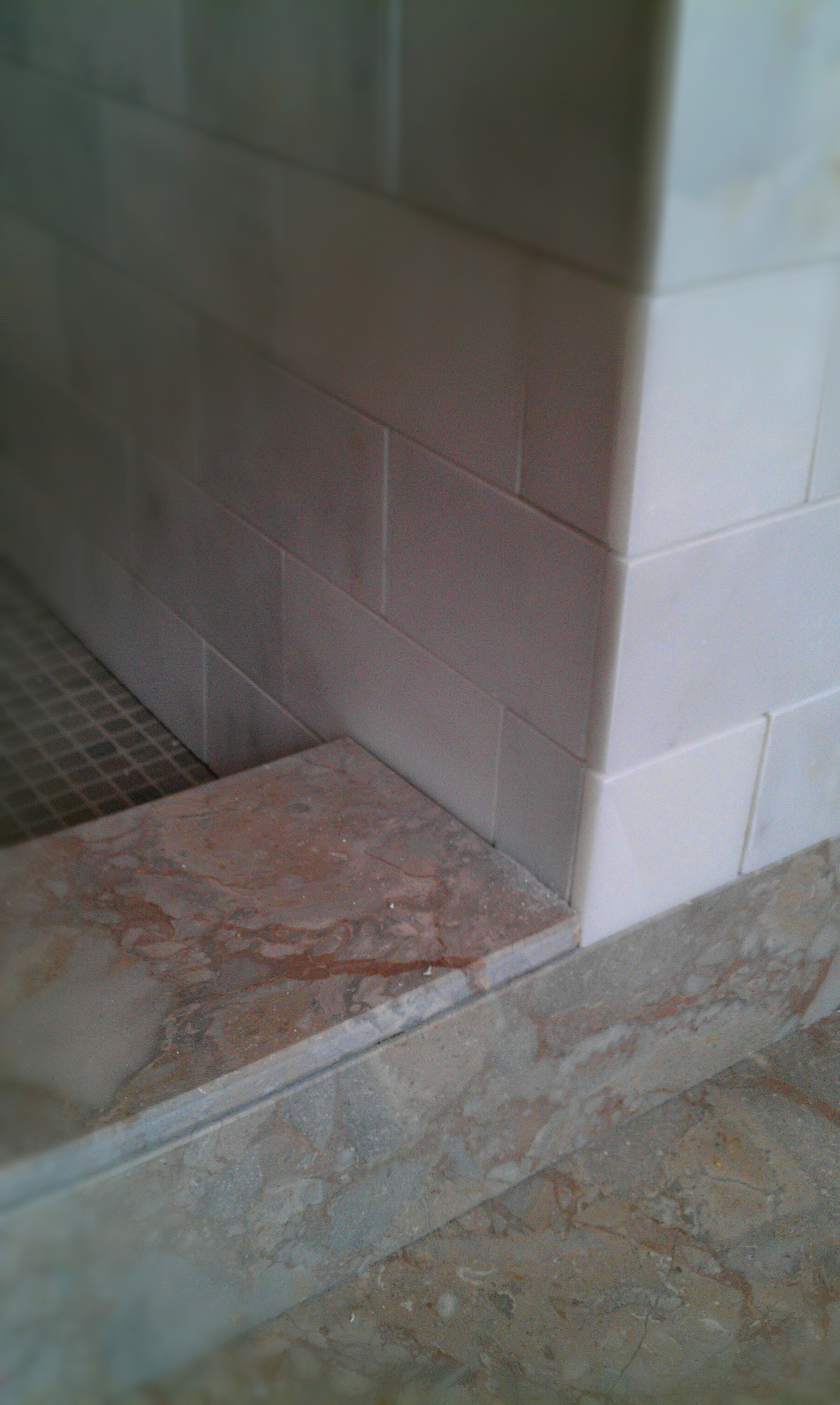 Marble shower detail. Floor meets curb meets pan meets knee wall ...