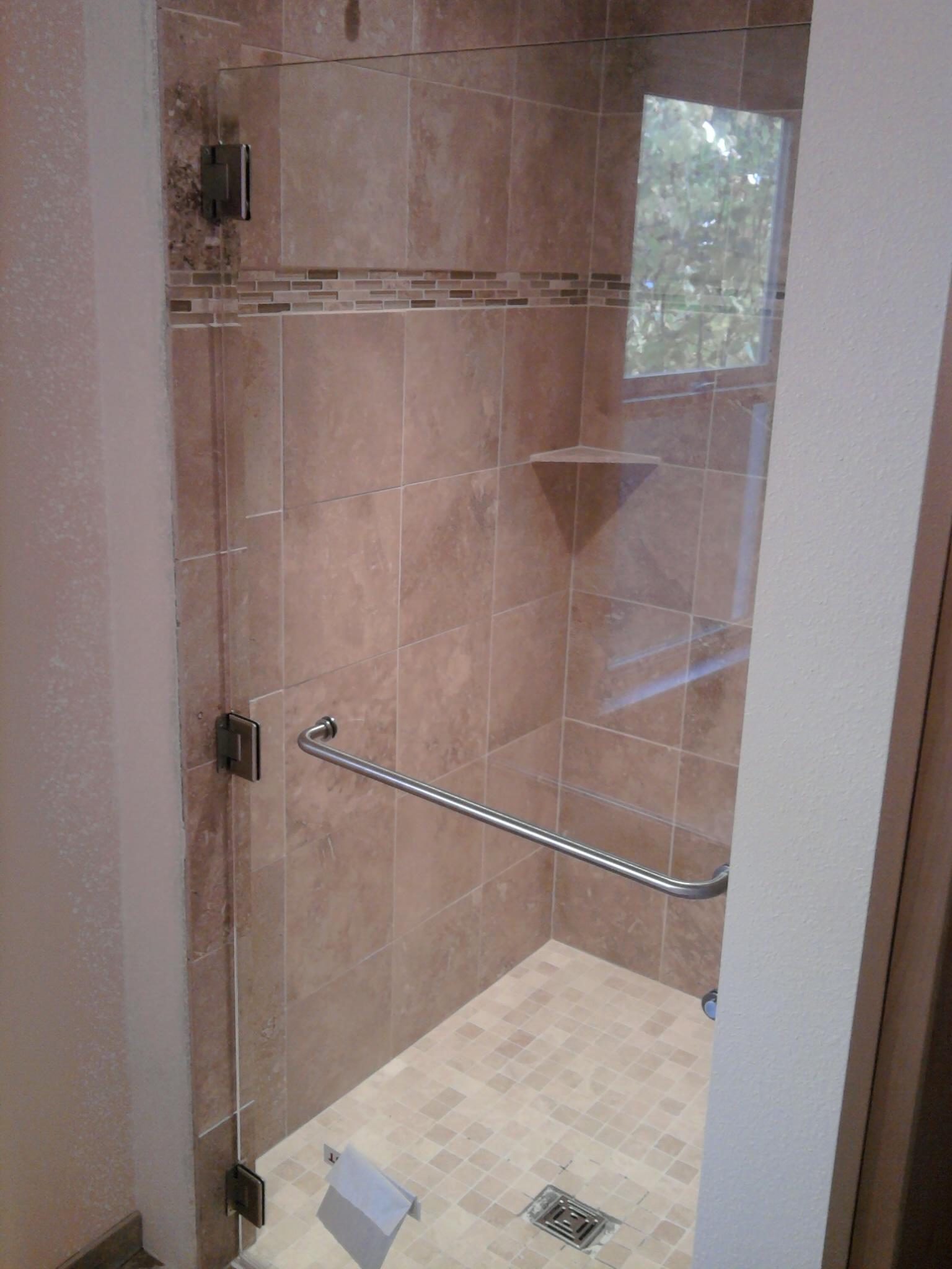 Glass shower door installed. - Old School Renovations, Inc.