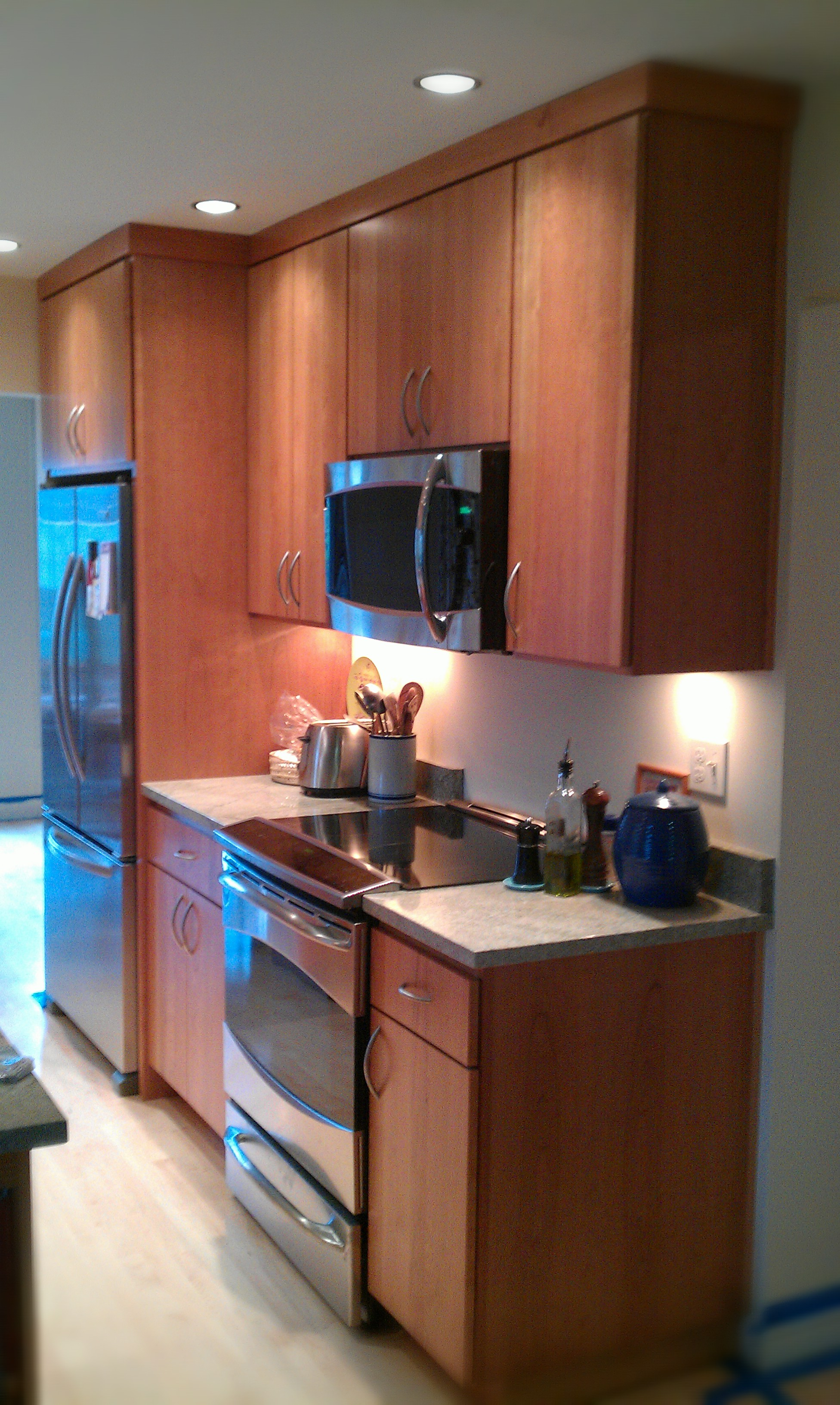 Kitchens R us Cherry cabinets with a solid slab mid century