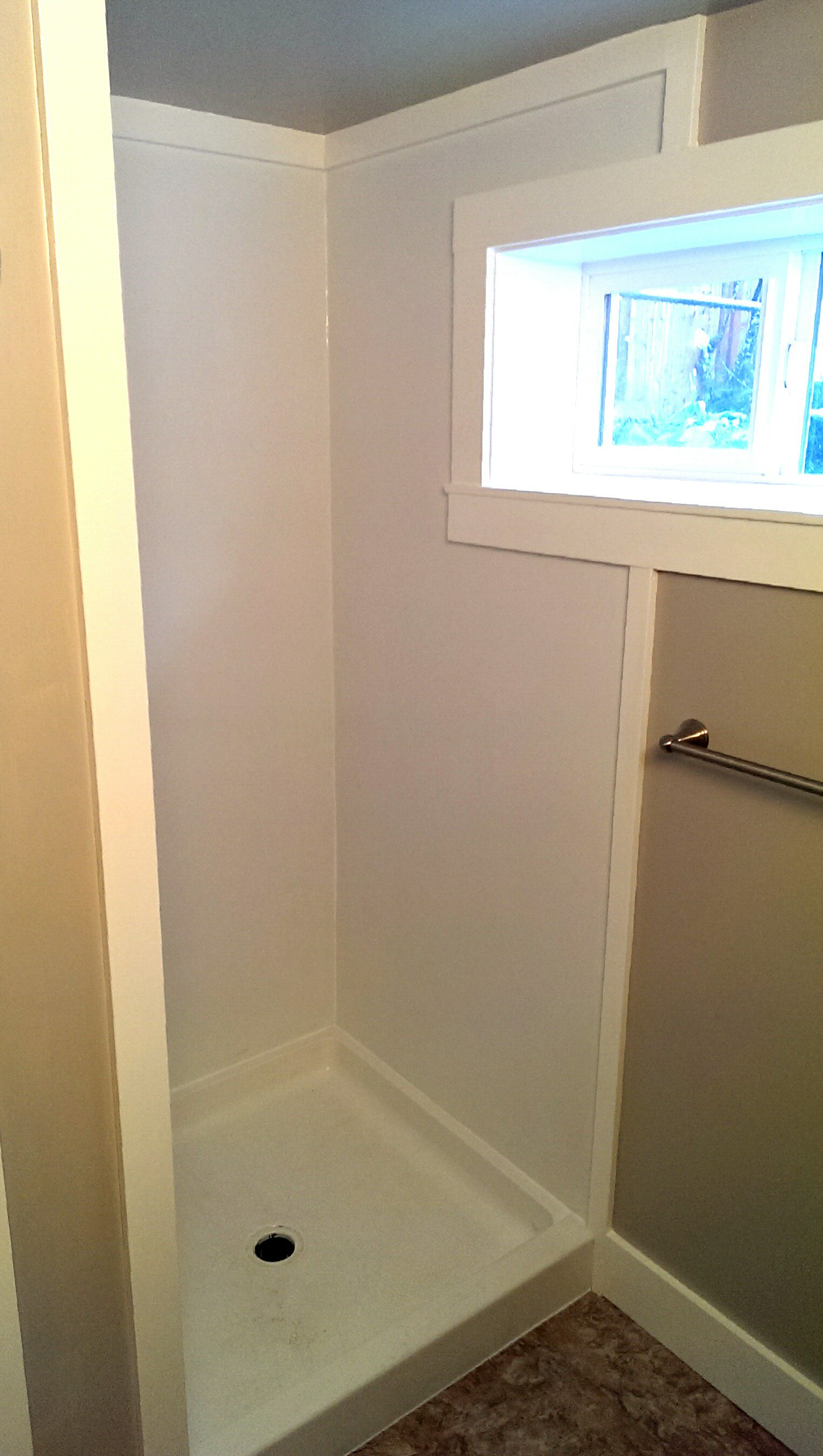 Basement shower on a budget. PVC walls and a stock size shower pan ...